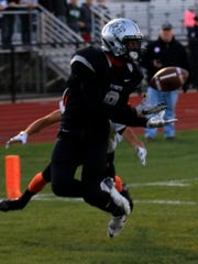 Snaring a 22-yard touchdown pass for Plymouth in the first quarter is senior Victor Abraham.