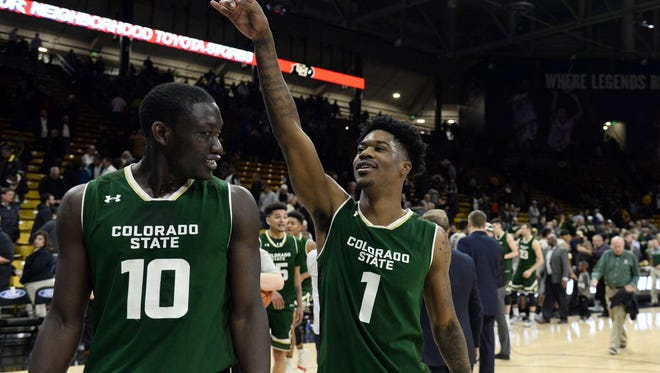 Nov 30, 2016; Boulder, CO, USA; Colorado State Rams guard Devocio Butler (1) and forward Che Bob (10) celebrate the win over the Colorado Buffaloes in the second half at Coors Events Center. The Rams defeated the Buffaloes 72-58. Mandatory Credit: Ron Chenoy-USA TODAY Sports