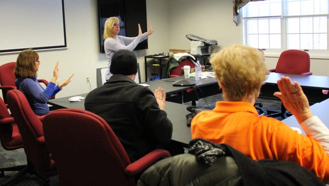 """Van drivers receive voluntary sign language training on Jan. 6 from Shannon Sharkey, supervisor of special education for Warren Township Schools. """"American Sign Language is an expressive means of communication in which any student might benefit through its visual representation,"""" Sharkey said."""