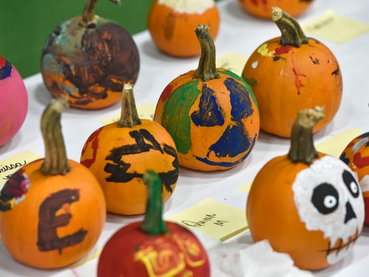 Painted pumpkins dry before going home with their creators Saturday, Oct. 28, in St. Cloud.