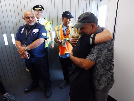 United Flight Attendant Bobbie Mas hugs her husband
