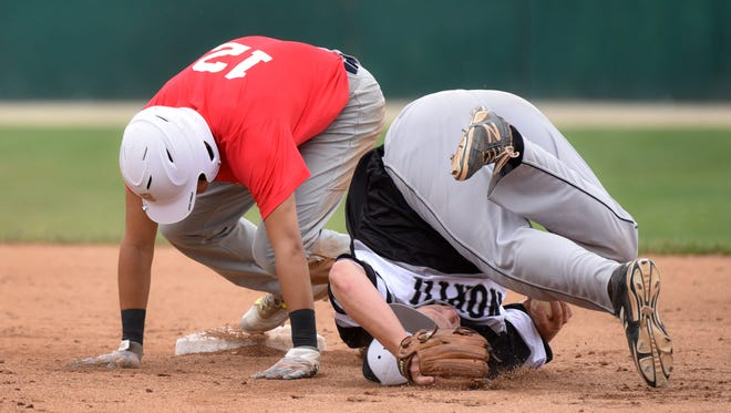 Hoosier North's Tucker Platt lands on his head after taking a throw at second base to get the out as Crowley, La defeats Hoosier North 12-2 in the Colt World Series on Sunday August 6, 2017 in Lafayette. Frank Oliver/For the Journal and Courier