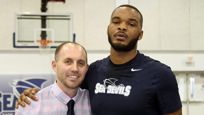 Tyrek Coger with Cape Fear Community College men's basketball coach Ryan Mantlo.