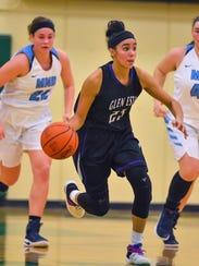 Jasmine Hale of Glen Este dribbles the ball up court