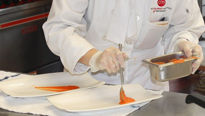 Baker College student Bethany McKenzie designs the perfect presentation, taking the culinary arts gold medal.