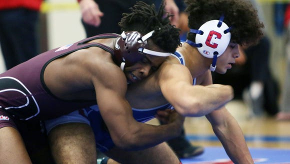 From left, Ossining's Josh Manning on his way to defeating