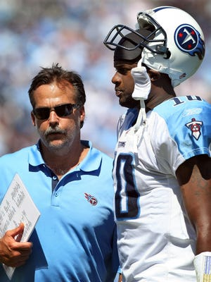 Titans head coach Jeff Fisher talks with quarterback Vince Young during a 2010 game in Nashville.