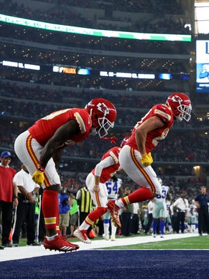 Kansas City Chiefs tight end Travis Kelce (87) celebrates with teammates after scoring a touchdown during the second half against the Dallas Cowboys.