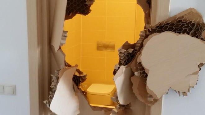 Picture of the broken door.