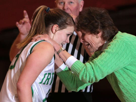 Irvington head coach Gina Maher celebrates with Riley