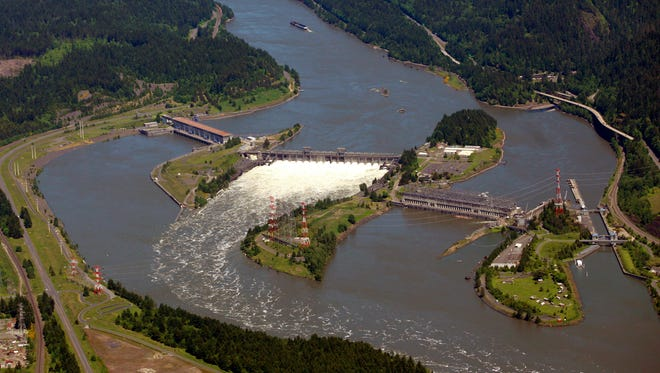FILE - This June 3, 2011, file photo shows the Bonneville Dam on the Columbia River near Cascade Locks, Ore. Talks are scheduled to begin Tuesday, May 29, 2018, in Washington, D.C., to modernize the document that coordinates flood control and hydropower generation in the U.S. and Canada along the Columbia River. (AP Photo/Rick Bowmer, File)