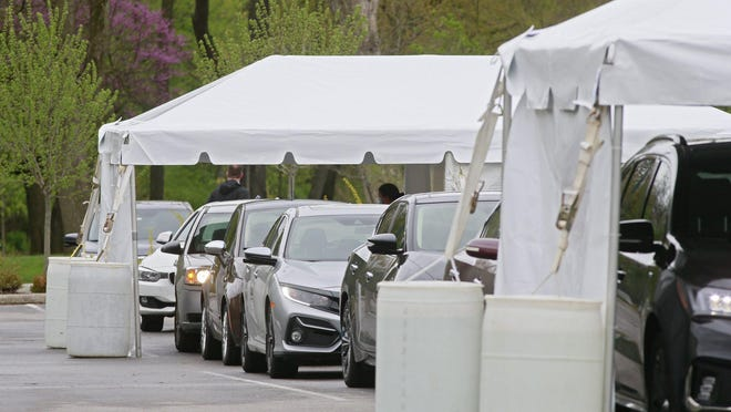 In this file photo, Kroger's first drive-through COVID-19 testing site has been opened at the Franklin Park Conservatory in Columbus on Thursday, April 30, 2020.