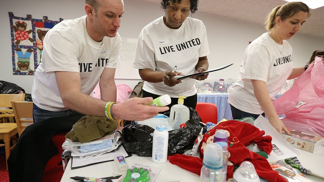 As part of United Way's Day of Caring, volunteers from Telamon sort donations of baby supplies at St. Elizabeth/Coleman Pregnancy and Adoption Services.