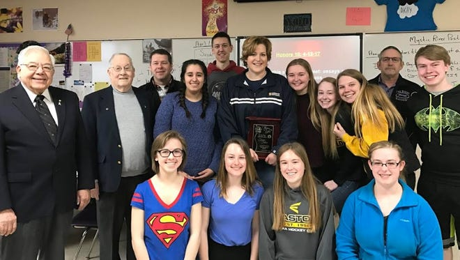 Two Rivers Elks representatives Bob Bergeon and Herman Gagnon presented Genal Hove with the Teacher of the Year Award during an Honors English class April 13.