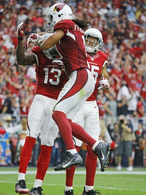 Cardinals wide receiver Jaron Brown (13) is greeted by wide receiver Larry Fitzgerald (11) and Michael Floyd (15) following his touchdown against the Buccaneers in the 2nd quarter, Sept. 18, 2016 in Glendale, Ariz.
