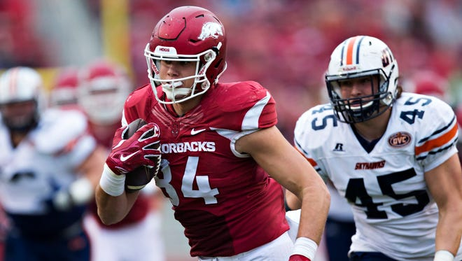 Arkansas tight end Hunter Henry runs the ball after catching a pass during a game against the UT Martin Skyhawks at Razorback Stadium.