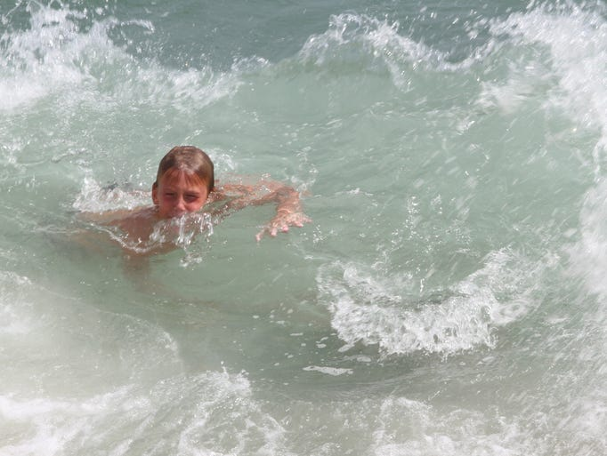 Dennis Forbes, 8, Toms River swims in the surf off Seaside Park during Labor Day at the shore.  Monday September 1, 2014 Seaside Park. Photo by Robert Ward