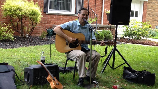 The Lathrup Summer Stroll features artists like Mark Reitenga, who perform on neighbors' lawns, porches or driveways.