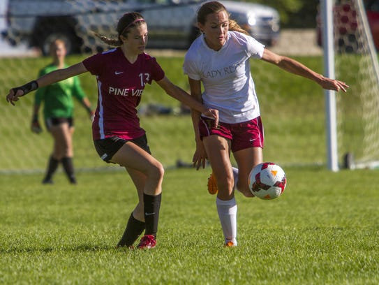 Morgan Myers (right) holds off a Pine View defender