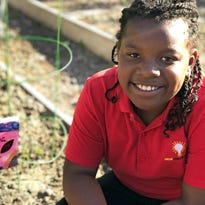 Generations in the garden: Planting vegetables brings family, community closer
