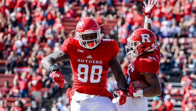 Rutgers Scarlet Knights running back Raheem Blackshear (25) celebrates his touchdown against the Purdue Boilermakers with tight end Jerome Washington (88) in the third quarter at High Point Solutions Stadium.