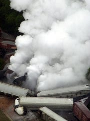 A plume of toxic smoke pours from a derailed train carrying sulfuric acid Sept. 15, 2002, in Farragut. In a recent report, Tennessee scored 6.7 out of 10 for managing community health crises.
