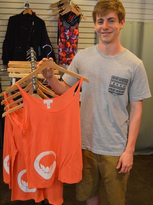 Horace Greeley High School senior Scott Silver, 18, sells his designs at the shop at Club Fit in Briarcliff Manor.