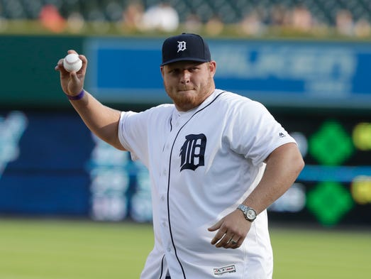 T.J. Lang throws out the first pitch at Comerica Park