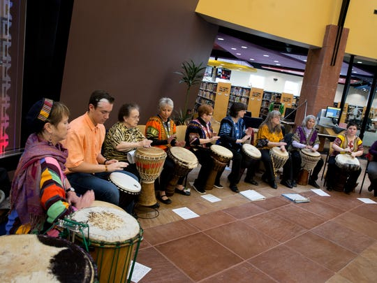 The Ashay Drummers perform during the Winter Solstice celebration on Thursday, Dec. 21, 2017 at the Farmington Public Library.