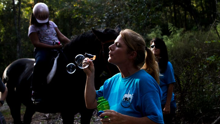 A unique therapy: Horses help special riders develop skills and confidence