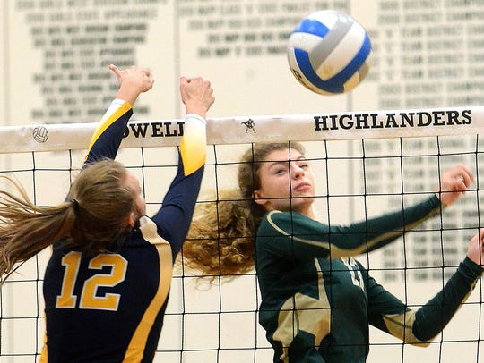 Howell's Jesccia Krakowiak hits the volleyball while