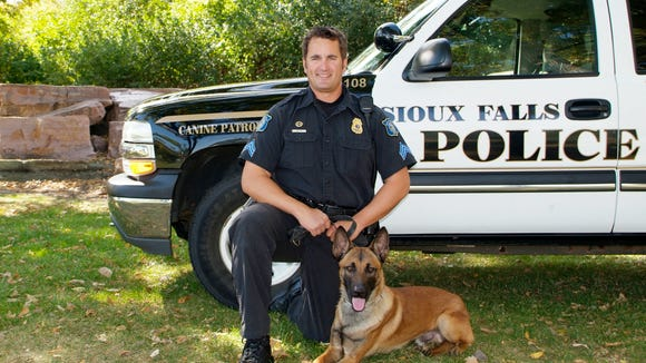 Jon Lohr worked on the K-9 unit in Sioux Falls. Here he poses with police dog Andor.
