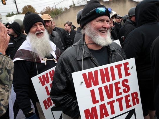 "Protesters hold signs during a ""White Lives Matter"""