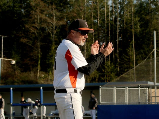 Bill Baxter coaches Central Kitsap during a game against Peninsula in March. Baxter will coach the Cougars for one more season, on a new turf field at CKHS, before becoming a full-time athletic director.