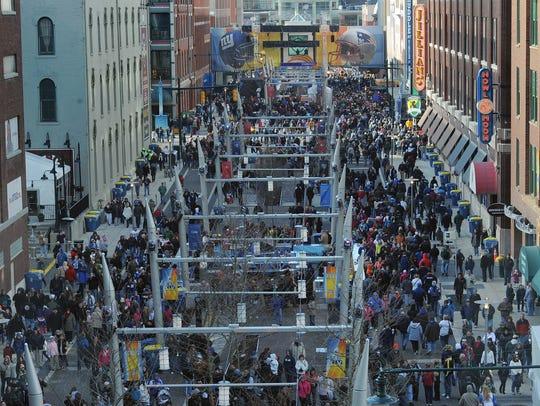 Masses of people descended on Super Bowl Village along Georgia Street in 2012.