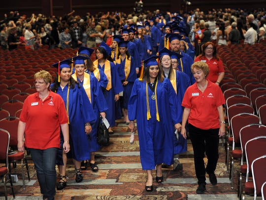 The procession of TMCC graduates at their graduation Friday May 23, 2014 at the Grand Sierra.