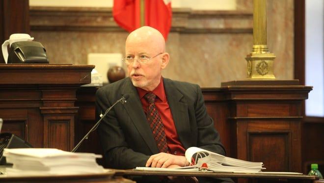Dr. Gregory Schmunk, Polk County medical examiner, testifies Thursday in Dr. Daniel Baldi's manslaughter trial.
