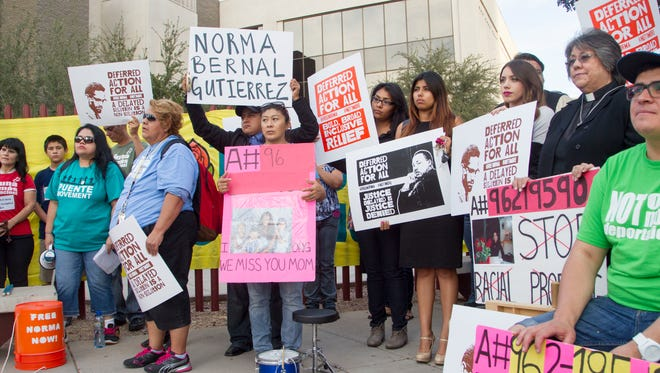 The activist group Puente holds a rally to speak out for deferred action for undocumented immigrants outside the ICE office in Phoenix on Nov 13, 2014.