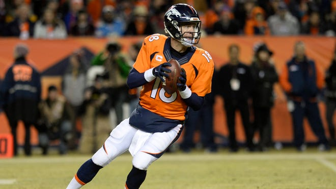 Denver Broncos quarterback Peyton Manning (18) drops back to pass the football in the fourth quarter against the San Diego Chargers on Jan. 3 at Sports Authority Field at Mile High. The Broncos defeated the Chargers 27-20. Mandatory Credit: Ron Chenoy-USA TODAY Sports