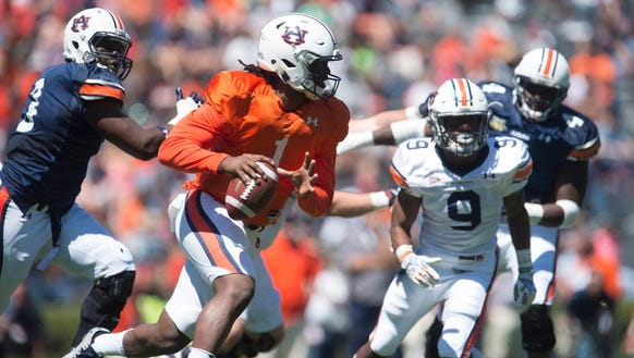 Auburn quarterback Woody Barrett (1) scrambles during