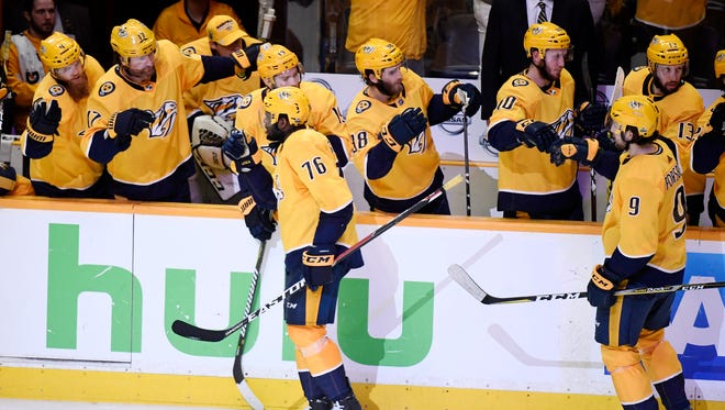 Predators defenseman P.K. Subban (76) celebrates his goal and left wing Filip Forsberg (9) his assist during the first period of Game 7 of the second-round series.