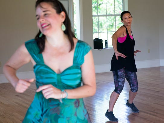 Linda Kurfist shakes her hips while mirroring instructor