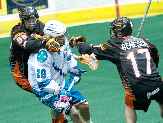 Buffalo's Mitch Wilde reaches for the ball over the Knighthawks' Stephen Keogh as blocking his path is Buffalo's Ryan Benesch.