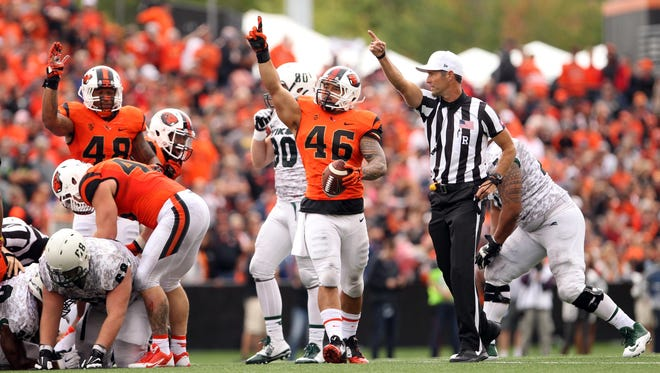 Oregon State Beavers linebacker Rommel Mageo (46) celebrates after recovering a fumble against Portland State. He's expected to be an important part of Ole Miss' defense this season.