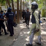 Bangladeshi police arrive near the scene of a blast in Kishoreganj, about 60 miles north of the capital of Dhaka, Bangladesh, on July 7, 2016. Islamic extremists hurled homemade bombs and engaged in a gunbattle with police guarding a large Eid prayer at the end of the holy Muslim month of Ramadan.