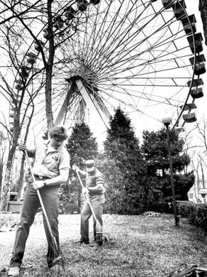 1996: Al Hopkins of Hamilton and Robert Elder of Pemberton clean up the grounds around the Big Wheel at Six Flags Great Adventure.