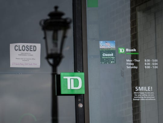 A closed sign at the TD bank on North Main Street on