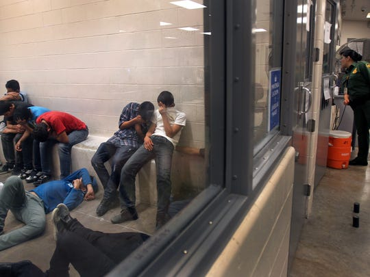 Immigrants who have been caught crossing the border illegally are housed inside the McAllen Border Patrol Station in McAllen, Texas where they are processed on Tuesday, July 15, 2014.  More than 57,000 unaccompanied children have been apprehended at the southwestern border since October, more than twice the total this time last year, many through the Rio Grande Valley.