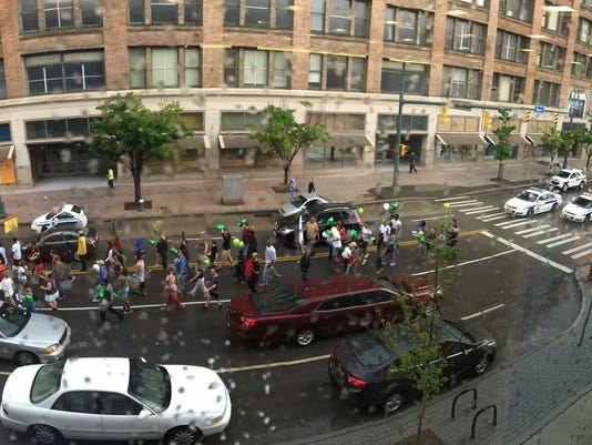 Protesters march down E. Main Street