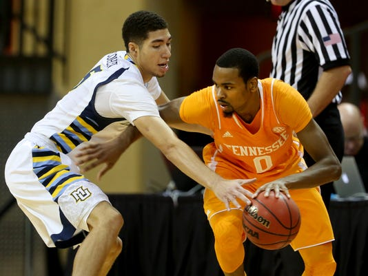 Kevin Punter (0) drives past Marquette forward Sandy Cohen III